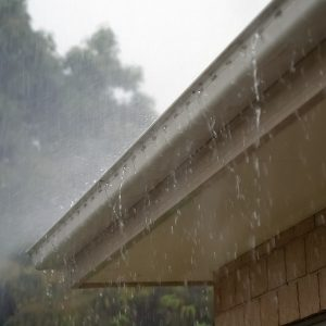 An image of rain coming down on a roof.