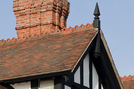 A close up image of a roof on listed building that has been restored by AES Roofing Contractors.