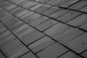An image of slate roofing up close and in situ in a roof.